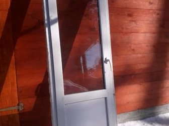 Дверь балконная б/ у,  Размеры 2,1м   на 0,66м в Бийске