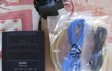 Двухдиапазонный модем ADSL2+ Annex A/B с портами Ethernet и USB